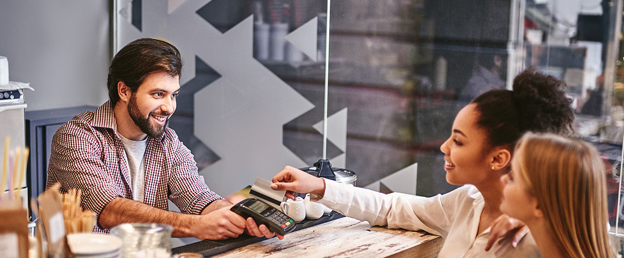 2 Women buying something
