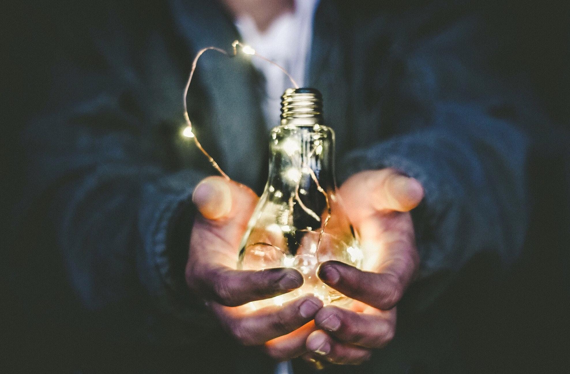 A man holding a bulb